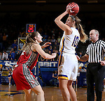 BROOKINGS, SD - FEBRUARY 4:  Kerri Young #10 from South Dakota State looks for a teammate while being guarded by Jaycee Bradley #12 from the University of South Dakota during their game Saturday afternoon at Frost Arena in Brookings. (Photo by Dave Eggen/Inertia)