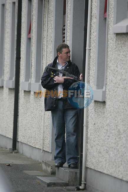 Armed guards man the doors of Drogheda Garda station as Thomas Slab Murphy is taken from Custody to a hearing of Ardee District Court in TAX evation charges.. Photo: Newsfile/Fran Caffrey.