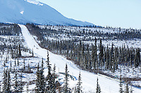 Janelle Trowbridge and Jimmy Lanier and teams run down the trail on the Denali Highway with the Alaska Range in the background during the start day of the 2015 Junior Iditarod on Sunday March 1, 2015<br /> <br /> <br /> <br /> (C) Jeff Schultz/SchultzPhoto.com - ALL RIGHTS RESERVED<br />  DUPLICATION  PROHIBITED  WITHOUT  PERMISSION