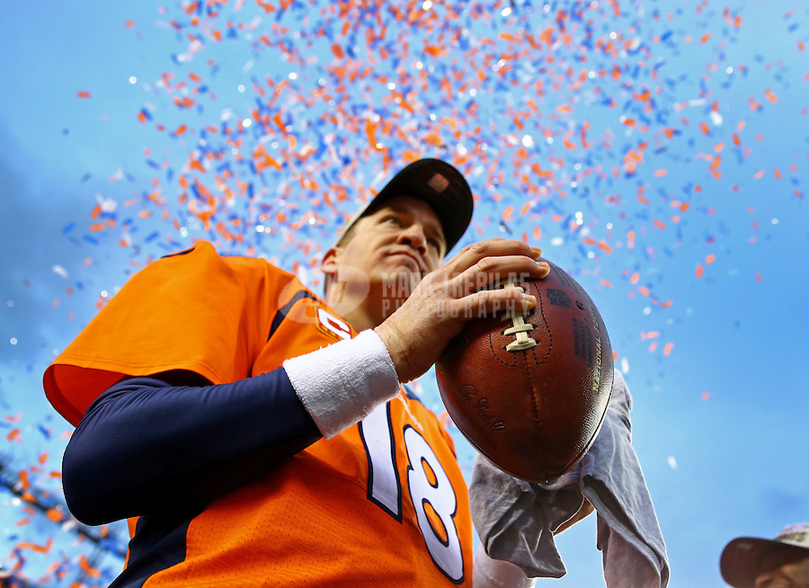 Jan 24, 2016; Denver, CO, USA; Detailed view of the game ball in the hand of Denver Broncos quarterback Peyton Manning (18) as confetti falls following the game against the New England Patriots in the AFC Championship football game at Sports Authority Field at Mile High. The Broncos defeated the Patriots 20-18 to advance to the Super Bowl. Mandatory Credit: Mark J. Rebilas-USA TODAY Sports