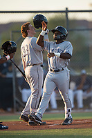AZL Padres 1 second baseman Lee Solomon (28) is congratulated by Nick Gatewood (33) after hitting a home run during an Arizona League game against the AZL Padres 2 at Peoria Sports Complex on July 25, 2018 in Peoria, Arizona. The AZL Padres 1 defeated the AZL Padres 2 10-1. (Zachary Lucy/Four Seam Images)