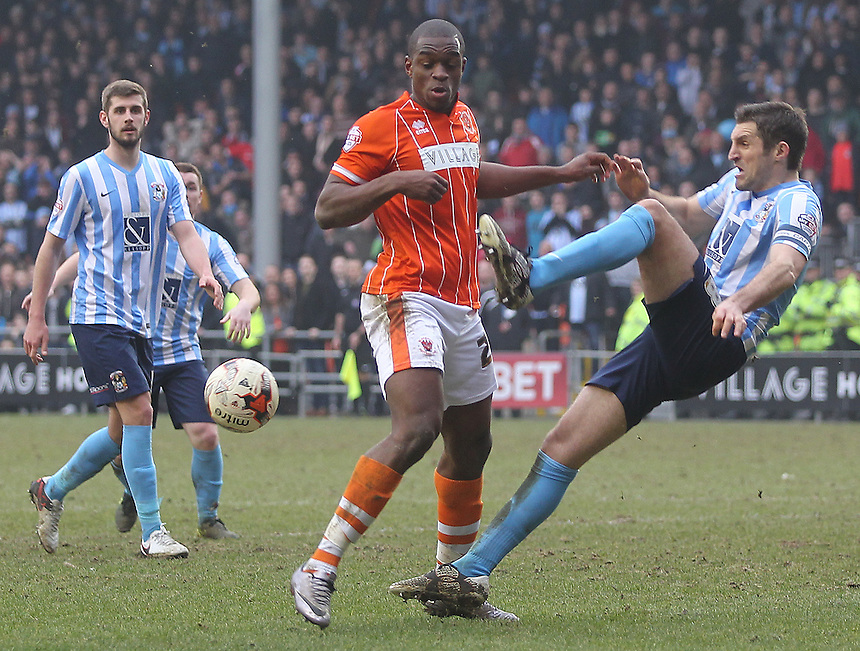 Blackpool's Uche Ikpeazu battles with Coventry City's Sam Ricketts<br /> <br /> Photographer Mick Walker/CameraSport<br /> <br /> Football - The Football League Sky Bet League One - Blackpool v Coventry City - Saturday 12th March 2016 - Bloomfield Road - Blackpool   <br /> <br /> &copy; CameraSport - 43 Linden Ave. Countesthorpe. Leicester. England. LE8 5PG - Tel: +44 (0) 116 277 4147 - admin@camerasport.com - www.camerasport.com