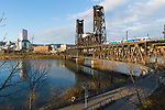 Morning view of Downtown Portland, Oregon and the Steel Bridge with the Willamette River from the Eastbank Esplanade