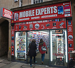 People entering Mobile Express shop in Cambridge city centre, England
