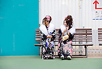 Kimono-clad woman sit on a bench at an amusement park in Tokyo Japan. Photographer: Robert Gilhooly
