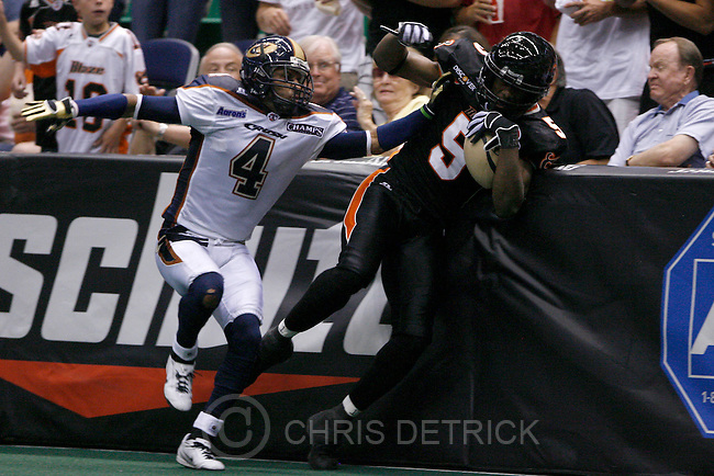 Colorado's Rashad Floyd, #4, knocks out Utah's JJ McKelvey, #5, out of bounds during the second half of the game at the EnergySolutions arena Saturday, June 28, 2008. The Blaze lost the game 44-49...Photo by Chris Detrick/The Salt Lake Tribune.frame #_2CD6245.