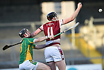 Alan Kilcoyne of Broadford in action against Alan O Neill of St Joseph's Doora Barefield during their Intermediate county final in Cusack Park. Photograph by John Kelly.