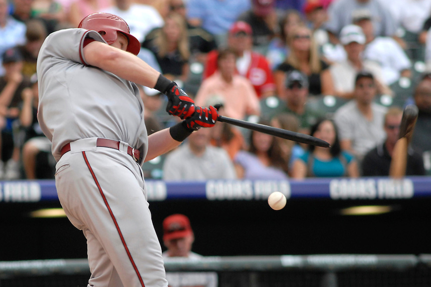 14 August 08: DBacks outfielder Adam Dunn breaks his bat during an at bat against the Colorado Rockies. The Arizona Diamondbacks defeated the Colorado Rockies 6-2 at Coors Field in Denver, Colorado. FOR EDITORIAL USE ONLY. FOR EDITORIAL USE ONLY