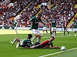 Chris Basham of Sheffield Utd brought down by Rico Henry of Brentford during the English championship league match at Bramall Lane Stadium, Sheffield. Picture date 5th August 2017. Picture credit should read: Jamie Tyerman/Sportimage