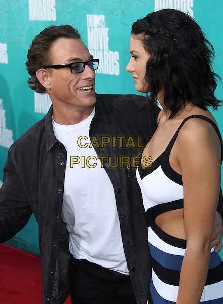 Jean-Claude Van Damme & Bianca Van Verenberg.2012 MTV Movie Awards held at the Gibson Amphitheatre, Universal City, California, UA..June 3rd, 2012.half length black white glasses tinted white blue striped stripes cut out away profile father dad daughter family profile smiling dress.CAP/ADM/RE.©Russ Elliot/AdMedia/Capital Pictures.