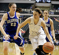 Columbus North's Paige Littrell, left, and Elle Williams attempt to trap Penn guard/forward Camryn Buhr (34) in the corner during the IHSAA Class 4A Girls Basketball State Championship Game on Saturday, Feb. 27, 2016, at Bankers Life Fieldhouse in Indianapolis.