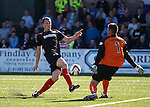 Jon Daly almost scores but the keeper puts him off