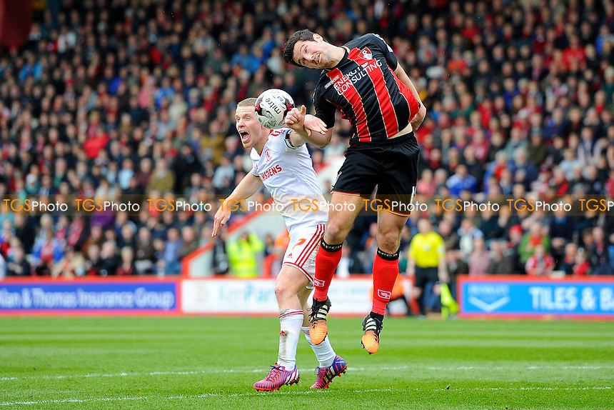Yann Kermorgant of AFC Bournemouth right and Grant Leaditter of Middlesbrough vie for a header in the penalty area - AFC Bournemouth vs Middlesbrough - Sky Bet Championship Football at the Goldsands Stadium, Bournemouth, Dorset - 21/03/15 - MANDATORY CREDIT: Denis Murphy/TGSPHOTO - Self billing applies where appropriate - contact@tgsphoto.co.uk - NO UNPAID USE