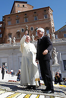 Papa Francesco tiene l'udienza generale del mercoledi' in Piazza San Pietro, Citta' del Vaticano, 3 giugno 2015.<br /> Pope Francis stands past a carpet of flowers as he arrives for his weekly general audience in St. Peter's Square at the Vatican, 3 June 2015.<br /> UPDATE IMAGES PRESS/Isabella Bonotto<br /> <br /> STRICTLY ONLY FOR EDITORIAL USE