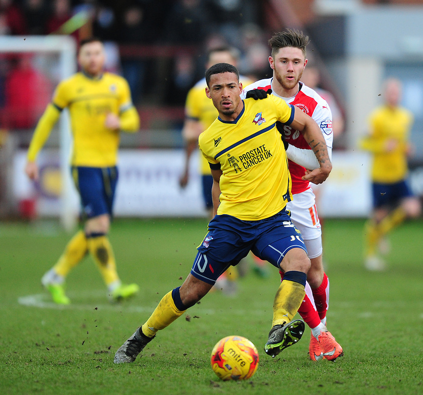 Scunthorpe United's Jordan Clarke shields the ball from Fleetwood Town&rsquo;s Wes Burns<br /> <br /> Photographer Chris Vaughan/CameraSport<br /> <br /> Football - The Football League Sky Bet League One - Fleetwood Town v Scunthorpe United  - Saturday 20th February 2016 - Highbury Stadium - Fleetwood    <br /> <br /> &copy; CameraSport - 43 Linden Ave. Countesthorpe. Leicester. England. LE8 5PG - Tel: +44 (0) 116 277 4147 - admin@camerasport.com - www.camerasport.com