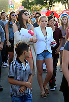 Keeping up with the Kardashians: Kris Jenner treated her daughter_Kylie and a bunch of friends with a trip to the Orange County Fair in Costa Mesa on a sunny Saturday afternoon. The Jenners were accompanied by Cody_Simpson's sister Alli_Simpson and a whole entourage of bodyguards and production people, who made sure that the outing was caught on film. ..Before the gang headed to the concert of Cody_Simpson on the Fair grounds, Kris grabbed a deep fried sweet treat and some ice cream and throw darts with_Kylie to win a stuffed animal. ..Kylie_and her friend later skipped the line at a thrill ride, which caused a couple of BOOs among the waiting crowd. The duo held hands and screamed from the top of their lungs during the ride but they clearly had a lot of fun! PICTURED: KYLIE JENNER AND ALLI SIMPSON. Costa Mesa, California on 21.7.2012..Credit: Kilian/face to face / Mediapunchinc - ***NO PRINT FOR WEEKLY MAGAZINES ONLINE ONLY**** */*NortePhoto*<br /> **CREDITO*OBLIGATORIO** <br /> **No*Venta*A*Terceros**<br /> **No*Sale*So*third**<br /> *** No*Se*Permite Hacer Archivo**<br /> **No*Sale*So*third**