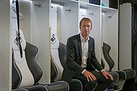 Pictured: Graham Potter sits on one of the seats in the changing room. Monday 11 June 2018<br /> Re: Graham Potter is announced as the new manager for Swansea City AFC at the Fairwood Training Ground, south Wales, UK.