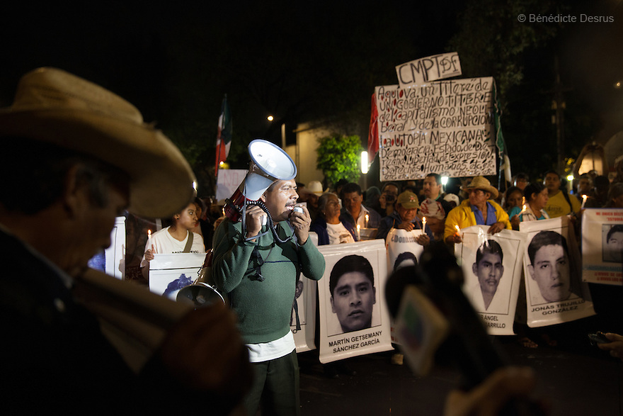 Demonstrators, along with the Parents and relatives of the 43 missing students of the Ayotzinapa Teacher Training College Raul Isidro Burgos during a New Year's Eve protest near Los Pinos presidential residence in Mexico City, Mexico on December 31, 2014. The relatives of the 43 missing students do not believe the official line that the young men are all dead. The 43students went missingon Sept. 26 after confrontations in which police gunfirekilled six peopleandwoundedat least25inIguala, in Guerrero state. Alexander Mora Venancio, one of the 43 Ayotzinapa's missingstudents, has been identified and confirmed dead by authorities.Many are demanding justice and that the search for the 42 missing students continue until there is concrete evidence to the contrary. Mexico – officially - lists more than 20 thousand people as having gone missing since the start of the country's drug war in 2006, and the search for the missing students has turned up other, unrelated mass graves.(Photo by BénédicteDesrus)
