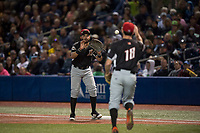 Salem-Keizer Volcanoes first baseman Robinson Medrano (7) prepares to catch a ball thrown by relief pitcher Ryan Walker (18) during a Northwest League game against the Hillsboro Hops at Ron Tonkin Field on September 1, 2018 in Hillsboro, Oregon. The Salem-Keizer Volcanoes defeated the Hillsboro Hops by a score of 3-1. (Zachary Lucy/Four Seam Images)