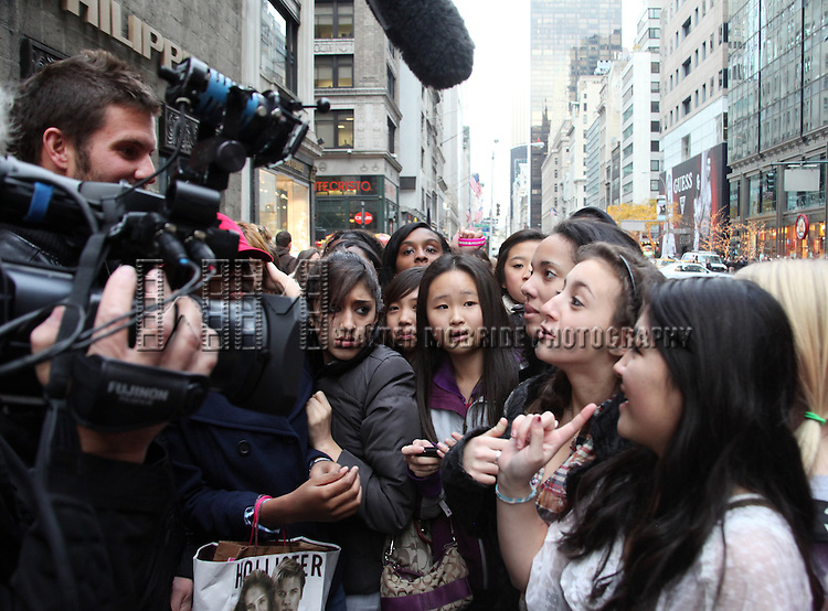 Justin Bieber promotes his new book 'First Step 2 Forever' at Barnes & Noble, 5th Avenue as fans hold a sing-a-long in New York City.