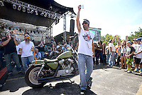 NWA Democrat-Gazette/BEN GOFF @NWABENGOFF<br /> Laramie LaFarge, master of ceremonies from Miami, Okla., leads fans in voting for their favorite bike with their cheers on Saturday Sept. 26, 2015 during the Stokes Air Battle of the Bikes at the annual Bikes, Blues & BBQ motorcycle rally in downtown Fayetteville. The bike seen here is the 'Jarhead' U.S. Marine Corps-inspired bike build by Scotty 'Memphis' Robertson and Matt Gillen of Steele, Mo.