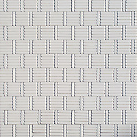 Wicker, a hand-cut tumbled mosaic, shown in Dolomite, is part of the Tissé™ collection for New Ravenna.