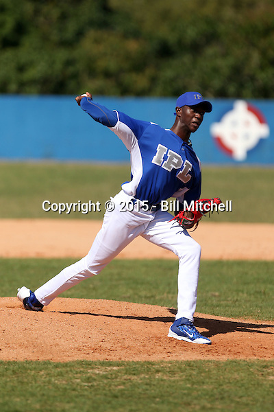 Yadier Alvarez works out at the Dominican Republic air force base in front of 100+ Major League Baseball scouts prior to being declared eligible to sign since defecting from his native Cuba in Santo Domingo, Dominican Republic on February 11, 2015 (Bill Mitchell)