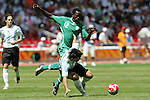 23 August 2008: Ebenezer Ajilore (NGA) (12) tries to win the ball from Sergio Aguero (ARG) (front). Argentina's Men's National Team defeated Nigeria's Men's National Team 1-0 at the National Stadium in Beijing, China in the Gold Medal match in the Men's Olympic Football tournament.