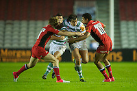 130712 Copyright onEdition 2012 ©.Free for editorial use image, please credit: onEdition..Alex Gray of London Irish is tackled by Jackson Wray (left) and Nathan Earle of Saracens at The Stoop, Twickenham in the first round of The J.P. Morgan Asset Management Premiership Rugby 7s Series...The J.P. Morgan Asset Management Premiership Rugby 7s Series kicked off again for the third season on Friday 13th July at The Stoop, Twickenham with Pool B being played at Edgeley Park, Stockport on Friday, 20th July, Pool C at Kingsholm Gloucester on Thursday, 26th July and the Final being played at The Recreation Ground, Bath on Friday 3rd August. The innovative tournament, which involves all 12 Premiership Rugby clubs, offers a fantastic platform for some of the country's finest young athletes to be exposed to the excitement, pressures and skills required to compete at an elite level...The 12 Premiership Rugby clubs are divided into three groups for the tournament, with the winner and runner up of each regional event going through to the Final. There are six games each evening, with each match consisting of two 7 minute halves with a 2 minute break at half time...For additional images please go to: http://www.w-w-i.com/jp_morgan_premiership_sevens/..For press contacts contact: Beth Begg at brandRapport on D: +44 (0)20 7932 5813 M: +44 (0)7900 88231 E: BBegg@brand-rapport.com..If you require a higher resolution image or you have any other onEdition photographic enquiries, please contact onEdition on 0845 900 2 900 or email info@onEdition.com.This image is copyright the onEdition 2012©..This image has been supplied by onEdition and must be credited onEdition. The author is asserting his full Moral rights in relation to the publication of this image. Rights for onward transmission of any image or file is not granted or implied. Changing or deleting Copyright information is illegal as specified in the Copyright, Design and Patents Act 1988. If you are in any way unsure of your right