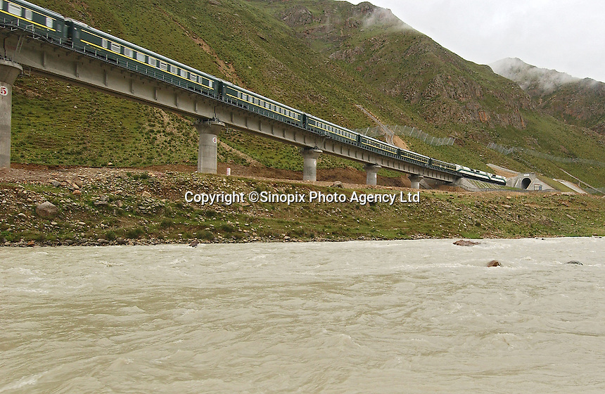 A train passes over a mountain torrent on the Tibet railway in Toling Valley, Tibet, China. Some 3% of the route between Golmud in Qinghai province and Lhasa in Tibet is composed of bridges and tunnels, according to official figures.   .08 Jul 2006