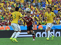 FORTALEZA - BRASIL -04-07-2014. Teofilo Gutierrez (#9) jugador de Colombia (COL) disputa un balón con David Luiz (#4) y Tiago Silva (#3) jugadores de Brasil (BRA) durante partido de los cuartos de final por la Copa Mundial de la FIFA Brasil 2014 jugado en el estadio Castelao de Fortaleza./ Teofilo Gutierrez (#9) player of Colombia (COL) fights the ball with David Luiz (#4) and Tiago Silva (#3) player of Brazil (BRA) during the match of the Quarter Finals for the 2014 FIFA World Cup Brazil played at Castelao stadium in Fortaleza. Photo: VizzorImage / Alfredo Gutiérrez / Contribuidor