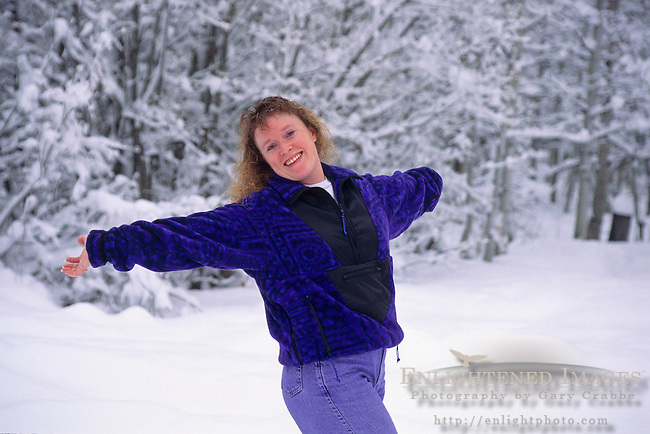Woman enjoying the snow in winter, near South Lake Tahoe, California