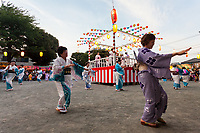 Women dance at a traditional Summer Bon Odori matsuri (festival) in Tsuruma, Kanagawa, Japan. Saturday July 21st 2018