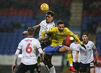 Bolton Wanderers' Josh Magennis competing with Leeds United's Lewis Baker<br /> <br /> Photographer Andrew Kearns/CameraSport<br /> <br /> The EFL Sky Bet Championship - Bolton Wanderers v Leeds United - Saturday 15th December 2018 - University of Bolton Stadium - Bolton<br /> <br /> World Copyright &copy; 2018 CameraSport. All rights reserved. 43 Linden Ave. Countesthorpe. Leicester. England. LE8 5PG - Tel: +44 (0) 116 277 4147 - admin@camerasport.com - www.camerasport.com