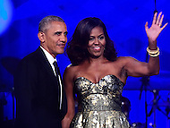 Washington, DC - September 17, 2016: President Barack Obama and first lady Michelle Obama wave to the audience after speaking at the Phoenix Awards Dinner hosted by the Congressional Black Caucus Foundation at the Washington Convention Center, in the District of Columbia, September 17, 2016.  (Photo by Don Baxter/Media Images International)