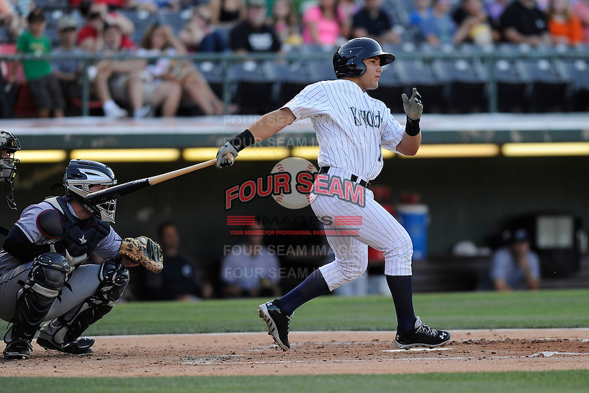 Second baseman Carlos Sanchez (13) of the Charlotte Knights bats in a game against the Columbus Clippers on Saturday, June 15, 2013, at Knights Stadium in Fort Mill, South Carolina. The Columbus catcher is Roberto Perez. Columbus won, 4-2. (Tom Priddy/Four Seam Images)