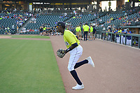 Shortstop Ronny Mauricio (2) of the Columbia Fireflies is introduced and runs onto the field in a game against the Augusta GreenJackets on Friday, May 31, 2019, at Segra Park in Columbia, South Carolina. Augusta won, 8-6. (Tom Priddy/Four Seam Images)