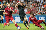 Leicester City FC forward Jamie Vardy (C) fights for the ball with Liverpool FC defenders Ragnar Klavan (L) and Alberto Moreno (R) during the Premier League Asia Trophy match between Liverpool FC and Leicester City FC at Hong Kong Stadium on 22 July 2017, in Hong Kong, China. Photo by Weixiang Lim / Power Sport Images