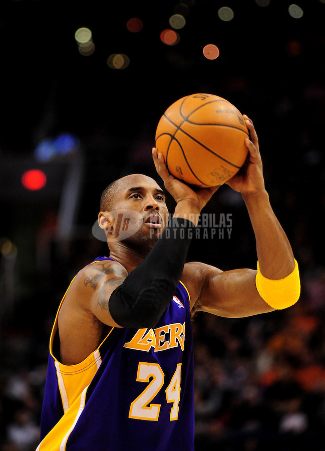 Dec. 28, 2009; Phoenix, AZ, USA; Los Angeles Lakers guard (24) Kobe Bryant shoots a free throw against the Phoenix Suns at the US Airways Center. The Suns defeated the Lakers 118-103. Mandatory Credit: Mark J. Rebilas-