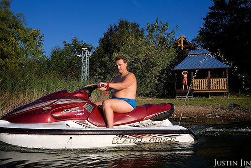 Russian billionaire Sergei Veremeenko rides his jet-ski in front of his country house in Moscow, Russia.