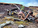 03/11/14<br /> <br /> Wreckage at a crash site where thirteen airmen were killed when their bomber hit remote moorland high up in the Peak District 66 years ago today.<br /> <br /> Amazingly, the area on Bleaklow Moor is so remote that many of the aircraft&rsquo;s twisted remains, including at least two of engines from the B29 Superfortress still litter the site today.<br /> <br /> The American bomber, known as &lsquo;Over-Exposed!&rsquo; had been converted into a photo reconnaissance aircraft.<br /> <br /> In some of its earlier flights it had been used to photograph the nuclear bomb tests at Bikini Atoll in the Pacific Ocean and had also taken part in the Berlin airlift.<br /> Captain Landon P. Tanner took off on the morning of 3rd November 1948, at around 10.15 from Scampton, Lincolnshire heading on a routine flight to Burtonwood USAF base in Warrington. The B29 was carrying USAF wages among other things. The crew were due to return to the States in a few days.<br /> When &lsquo;Over Exposed!&rsquo; failed to arrive at Burtonwood an air search was initiated, and that afternoon blazing wreckage was spotted high on the moors near Higher Shelf Stones. By chance members of the Harpur Hill RAF Mountain Rescue Unit were just finishing an exercise two and a half miles away, so they quickly made their way to the scene of the crash but there was clearly nothing that could have been done for any of the crew.<br /> This is just one of 180 military and civilian aircraft that have crashed in and around the Peak District since 1918.<br /> <br /> All Rights Reserved - F Stop Press.  www.fstoppress.com. Tel: +44 (0)1335 300098