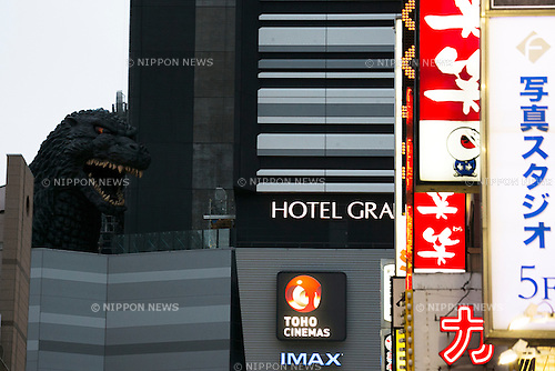 "A giant Godzilla head on display in a Shinjuku rooftop on March 8, 2015, Tokyo, Japan. A life size Godzilla head tops a new TOHO CINEMAS building in Tokyo, which will open in April. Next to the building a new Hotel Gracery Shinjuku will open its doors on April 24 offering special ""Godzilla View Rooms"", where guest can see the head of the monster from their windows. Prices for the rooms start from 15,000 yen (124 USD) per night. (Photo by Rodrigo Reyes Marin/AFLO)"