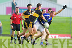 Daithi Casey and Brian Looney Dr Crokes in action against Micheal Quirke Kerins O'Rahillys in the Semi Finals of the Senior County Football Championship at Austin Stack Park on Sunday.