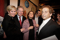 Michelle Dionne (L). Jean Charest ,<br /> Guerrera , Autistic, Jesus Carles de Vilallonga, painter (R).<br /> <br /> Internationally  know artist J C de Vilallonga donated recent painting for a benefit sales for tyhose with menyal disabilities, held at Parisian laundry in <br /> Montreal, canada<br /> <br /> photo : (c) 2005 Images Distribution