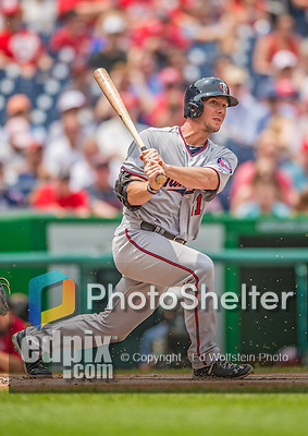 9 June 2013: Minnesota Twins outfielder Clete Thomas in action against the Washington Nationals at Nationals Park in Washington, DC. The Nationals shut out the Twins 7-0 in the first game of their day/night double-header. Mandatory Credit: Ed Wolfstein Photo *** RAW (NEF) Image File Available ***
