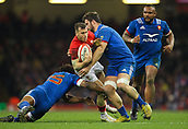 17th March 2018, Principality Stadium, Cardiff, Wales; NatWest Six Nations rugby, Wales versus France; Gareth Davies of Wales is tackled by Benjamin Fall and Marco Tauleigne of France