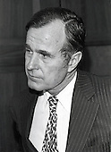 United States Ambassador to China George H.W. Bush listens to a reporter's questions during a break in his confirmation hearing to be Director of the U.S. Central Intelligence Agency (CIA) in Washington, D.C. on December 16, 1975.<br /> Credit: Benjamin E. &quot;Gene&quot; Forte / CNP