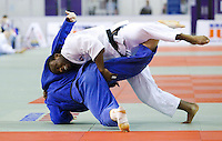 27 MAR 2011 - SHEFFIELD, GBR - Theodore Spalding-Mcintosh (white) throws Boris Kibrik (blue) to score ippon and win the men's under 100kg category at the English Senior Open Judo Championships (PHOTO (C) NIGEL FARROW)