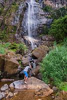 Photographer taking a photo of Bambarakanda Falls, a waterfall near Haputale, Sri Lanka Hill Country, Nuwara Eliya District, Asia. This is a photo of a photographer taking a photo of Bambarakanda Falls, a waterfall near Haputale, Sri Lanka Hill Country, Nuwara Eliya District, Asia.