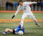 NEW BRITAIN, CT-111817JS12- Lewis Mills' Carter Viets (3) gets tripped up by Suffield's Jeremy Walch (22) during their Class M state final game Saturday at Willow Brook Park in New Britain.<br /> Jim Shannon Republican-American